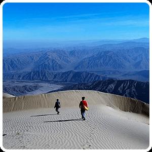 Sandboarding adventure on Cerro Blanco