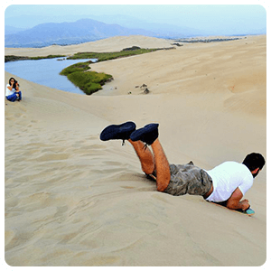 Sandboarding near the Moron Lagoon
