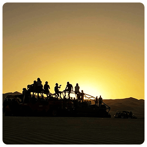 The sun setting over the Huacachina Dunes